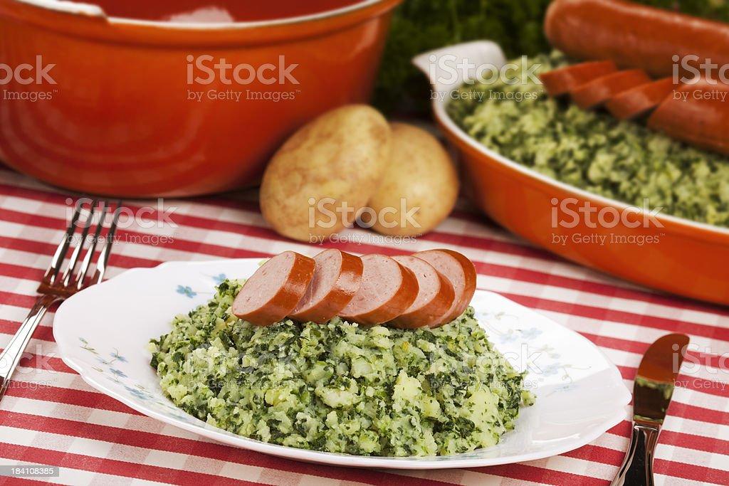 Dutch food: kale with smoked sausage or 'Boerenkool met worst' royalty-free stock photo