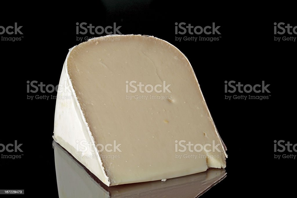Dutch goat cheese on a black background royalty-free stock photo