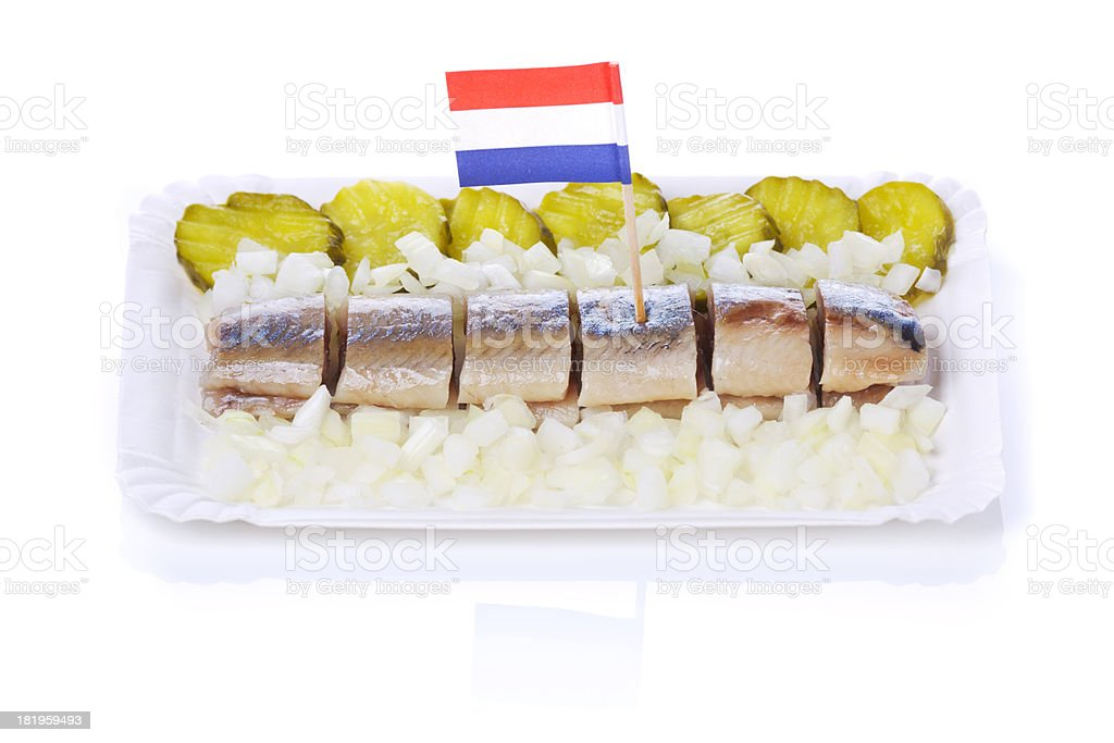 Dutch herring ('haring') with onions and pickles, isolated on white stock photo