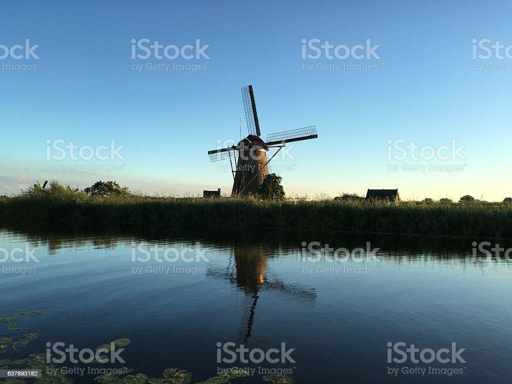 Dutch Holland windmill field canal sunset, Kinderdijk Netherland stock photo