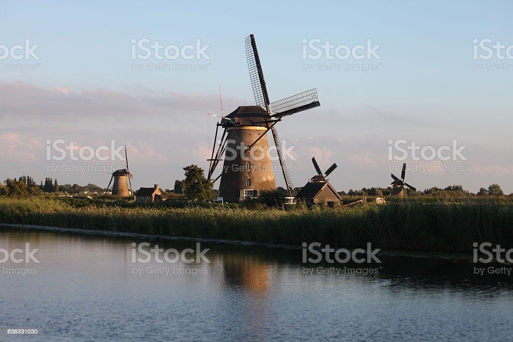 Dutch Holland windmill field canal sunset Kinderdijk Netherlands stock photo