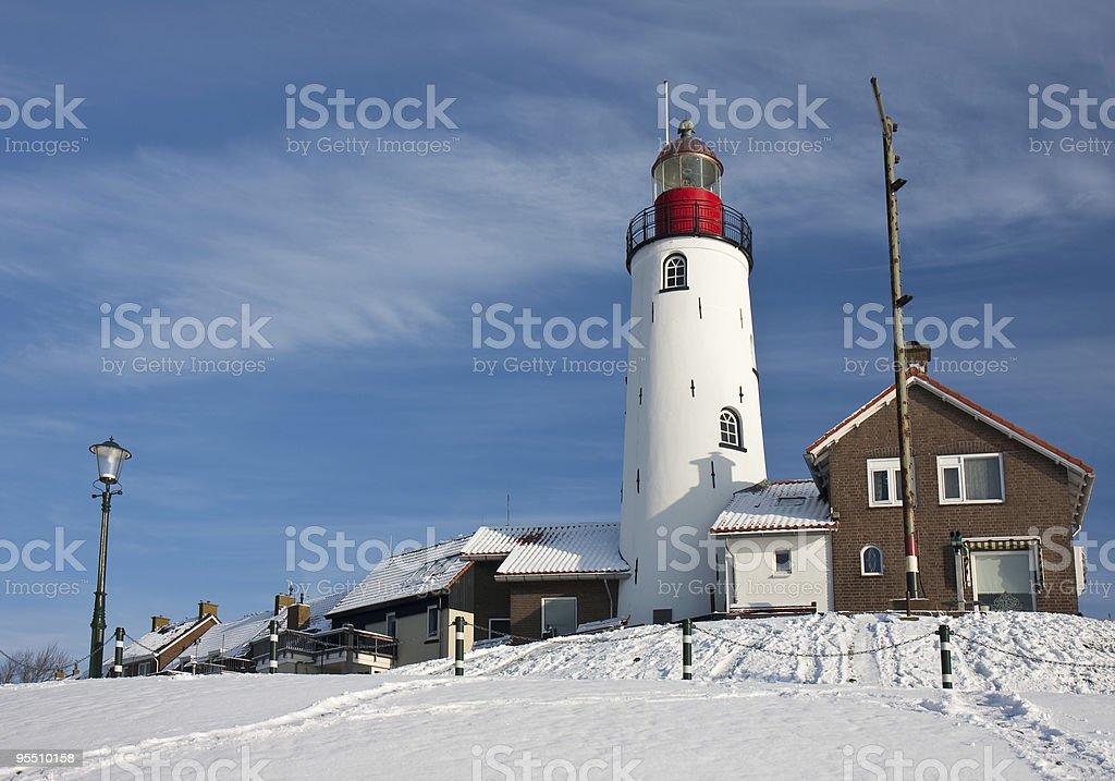 Dutch lighthouse in faboulus winter environment stock photo