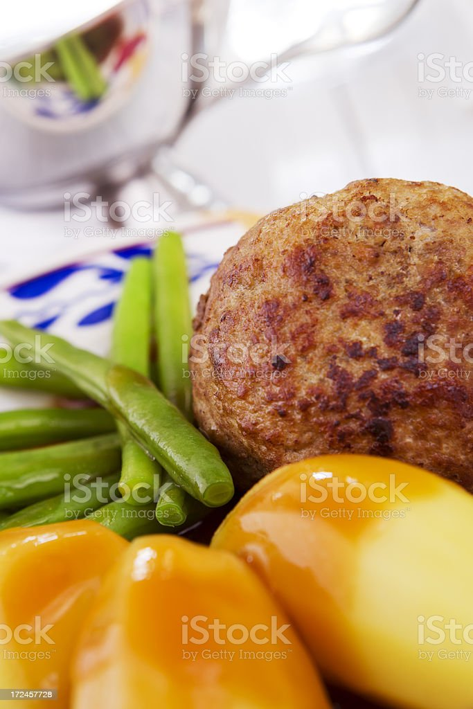 Dutch meal with meatball, potatoes and green beans royalty-free stock photo