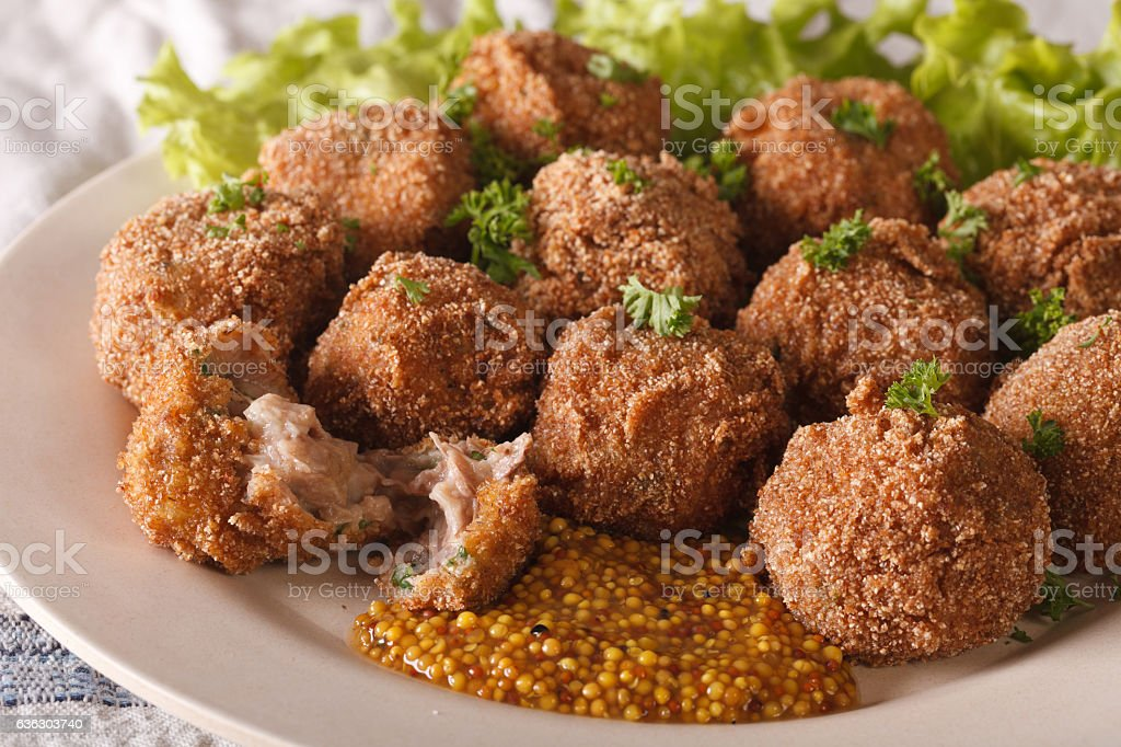 Dutch meat balls with mustard Bitterballen close-up on a plate. stock photo