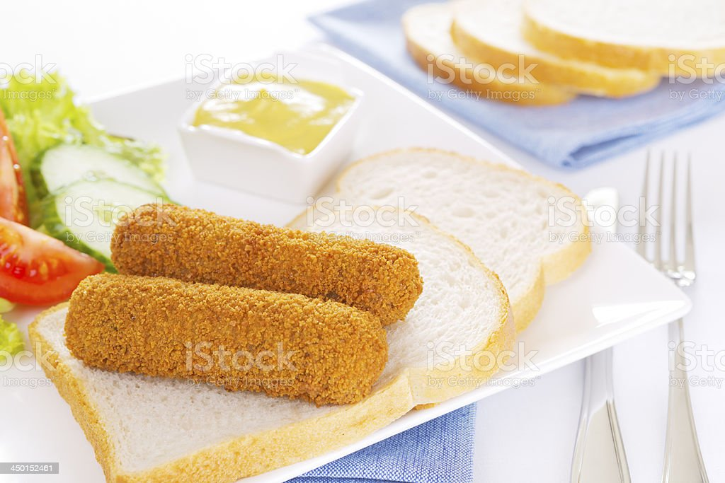 Dutch meat croquettes ('kroket') and bread on a plate stock photo