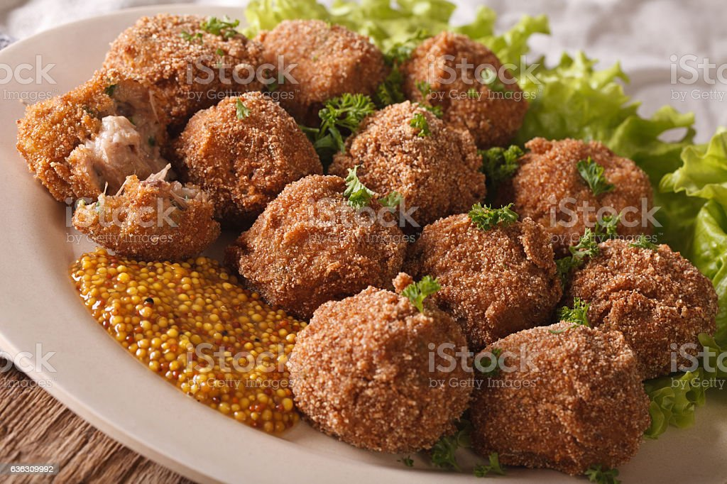 Dutch meat croquettes Bitterballen and mustard close up. Horizontal stock photo