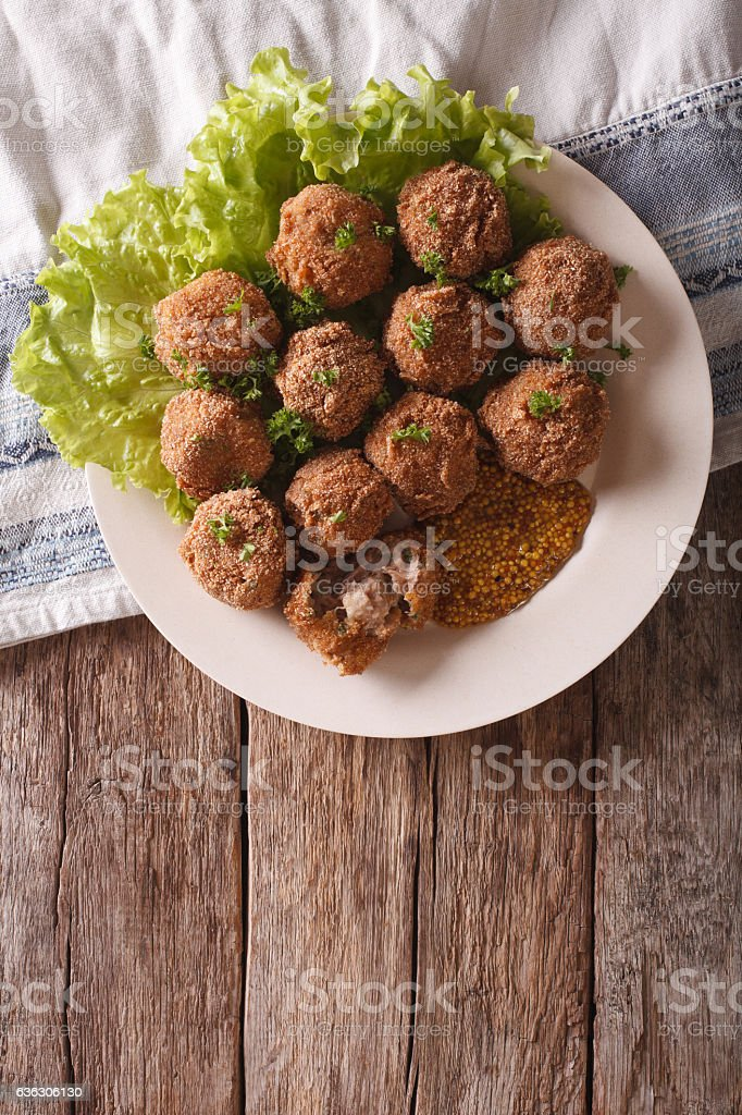 Dutch meat croquettes Bitterballen and mustard close up. vertical stock photo