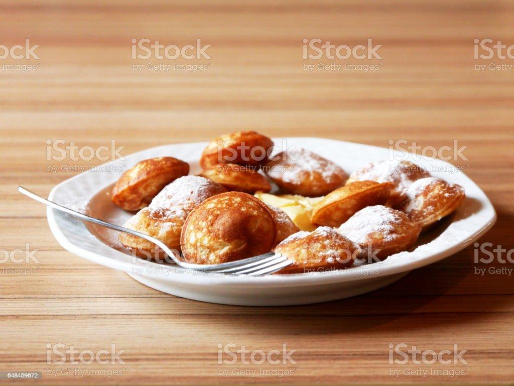 Dutch Mini Pancake (poffertjes) stock photo