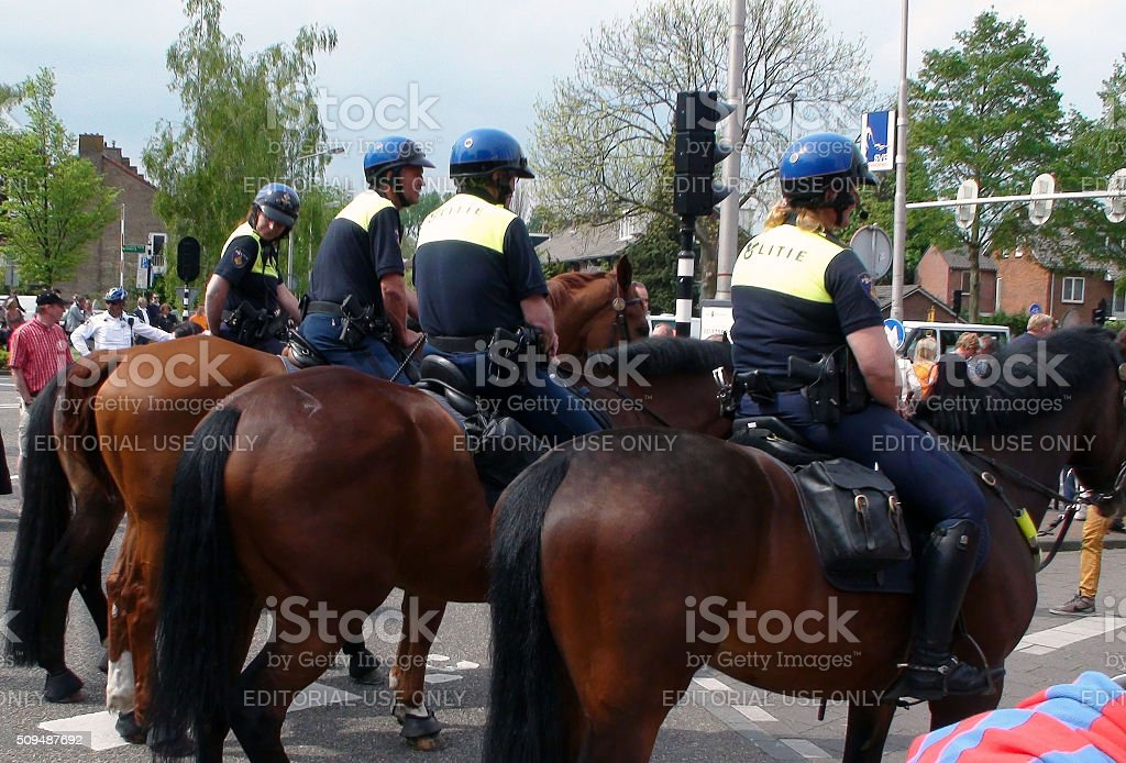 Dutch Mounted Police Officers On The Street For Security Reason.Amsterdam.Netherlands stock photo