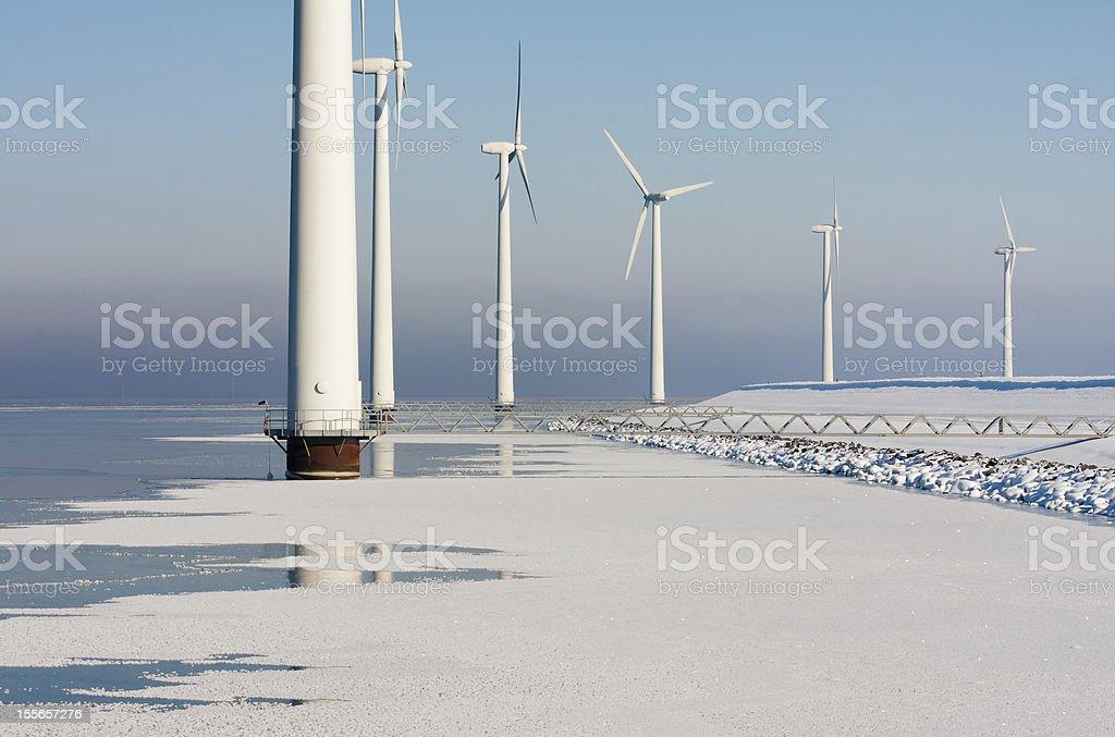 Dutch offshore windturbines in a frozen sea stock photo