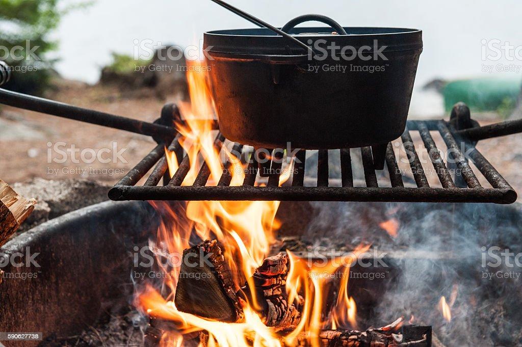 Dutch oven over a campfire stock photo