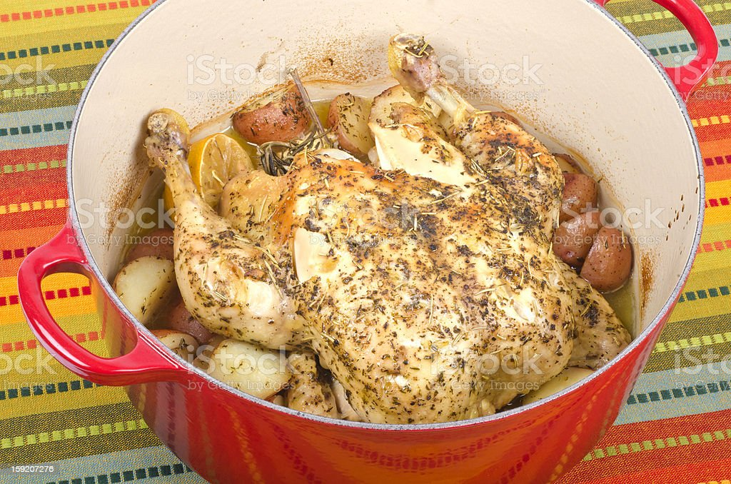 Dutch Oven Roasted Chicken with Lemon and Herbs royalty-free stock photo