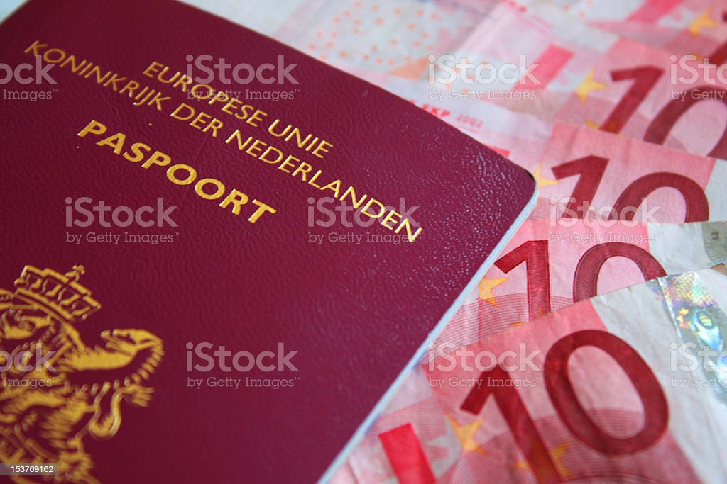 Dutch Passport and European Currency stock photo