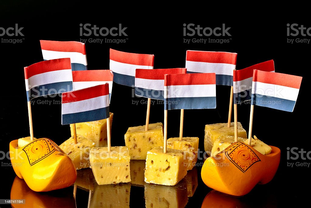 Dutch pickle cheese and clogs with flags royalty-free stock photo