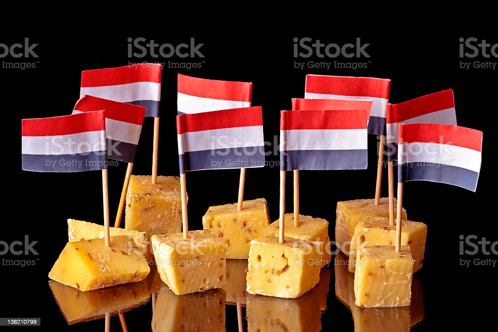 Dutch pickle cheese with flags from Holland royalty-free stock photo