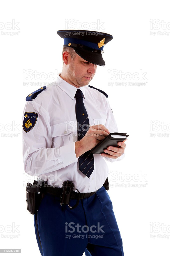 Dutch police officer filling out parking ticket. stock photo