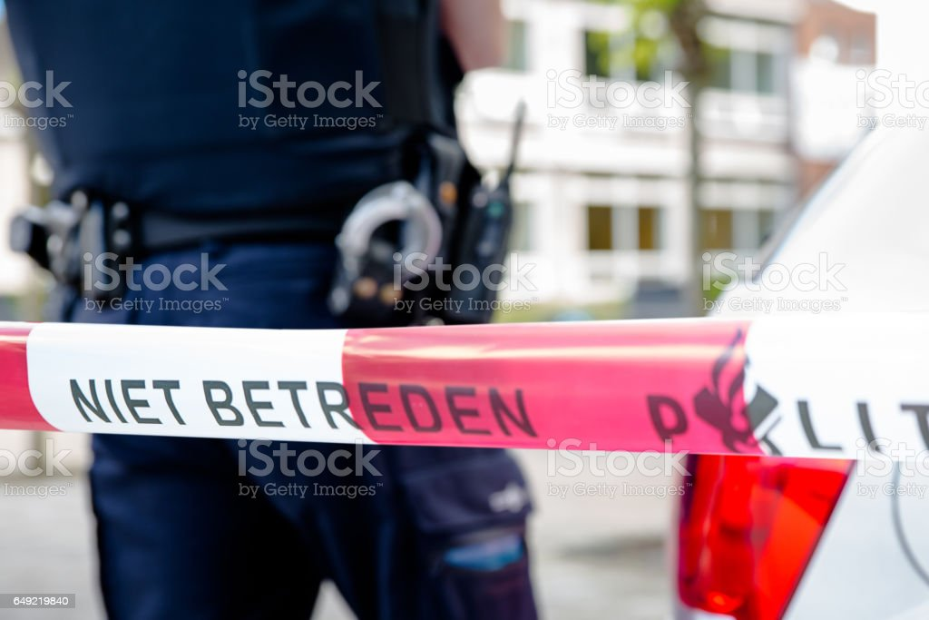 Dutch policeman behind plastic tape stock photo