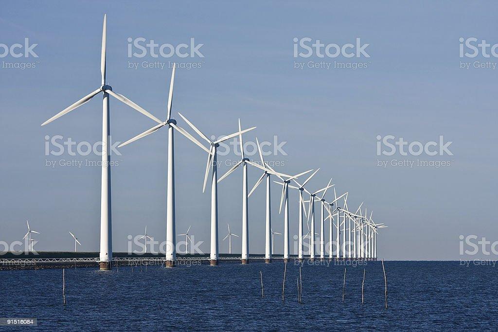 Dutch power by windmills stock photo