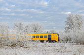 Dutch Railways commuter train driving through a frozen winter landscape