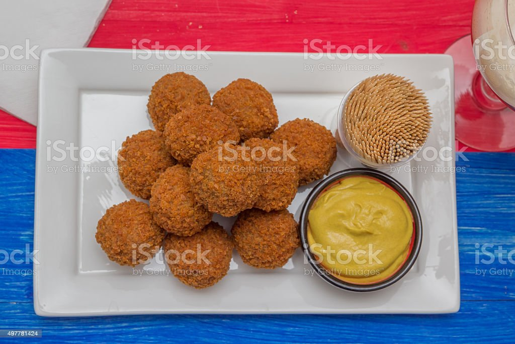 Dutch snack bitterballen on a colorful background stock photo