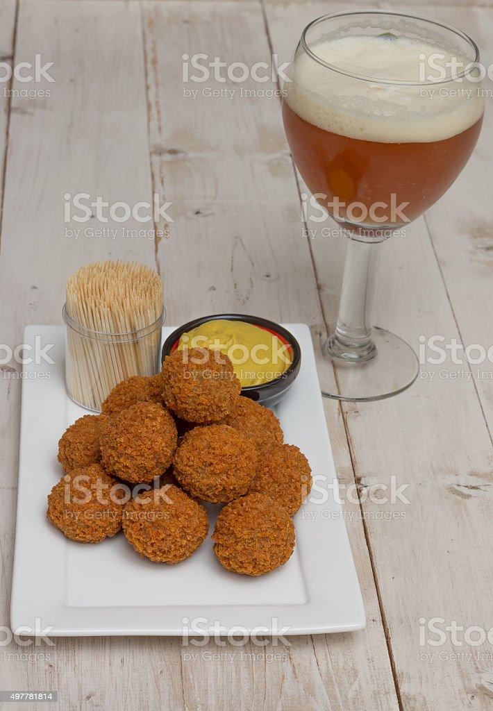 Dutch snack bitterballen with beer stock photo