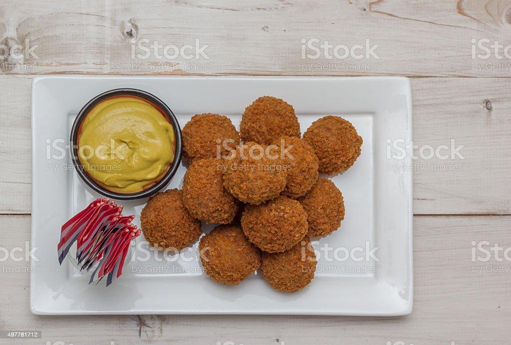 Dutch snack bitterballen with little dutch flags stock photo