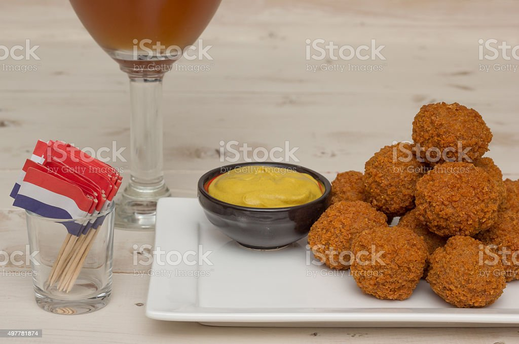 Dutch snack bitterballen with little flags and beer stock photo