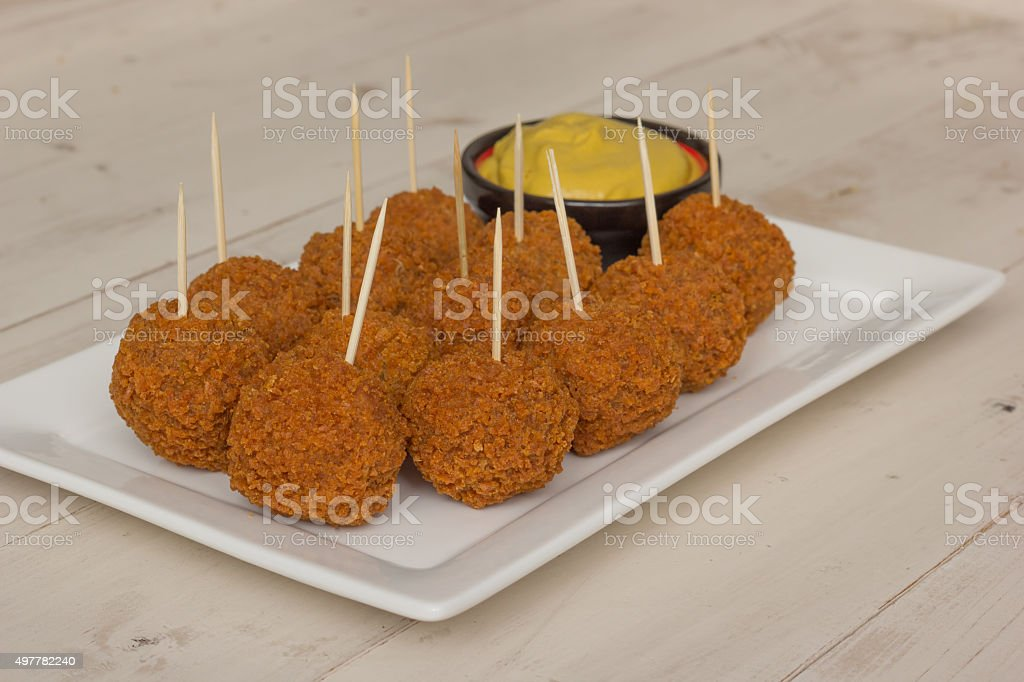 Dutch snack bitterballen with mustard and cocktail picks stock photo
