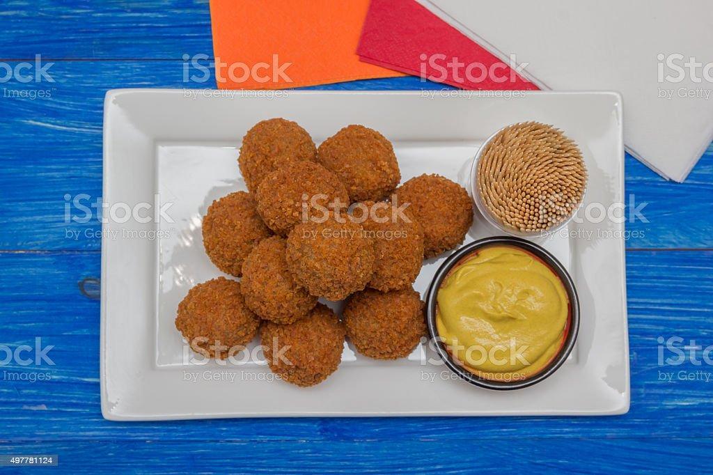 Dutch snack bitterballen with mustard stock photo