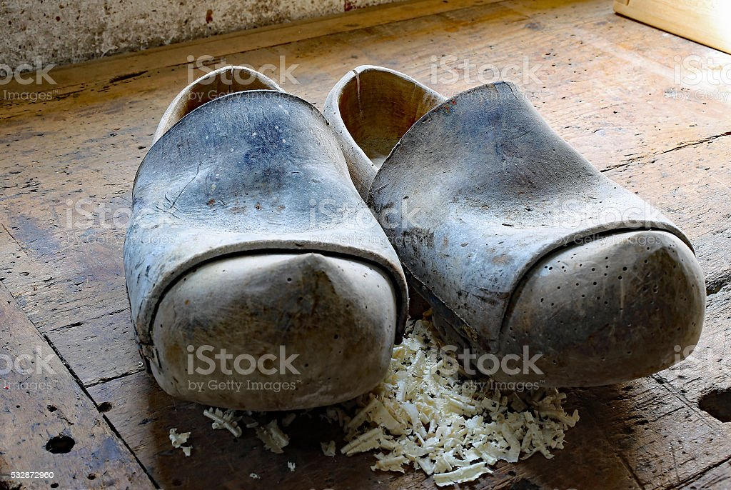 Dutch style wooden clogs in the workshop of a shoemaker stock photo