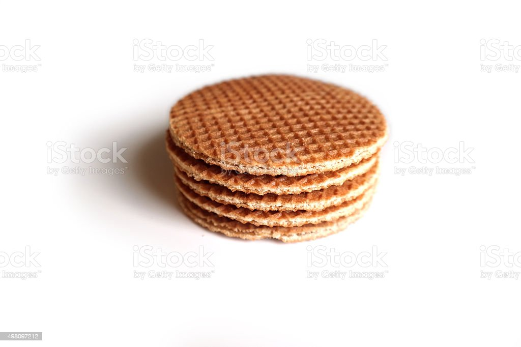 Dutch syrup waffle (stroopwafel) stack, on a white background stock photo