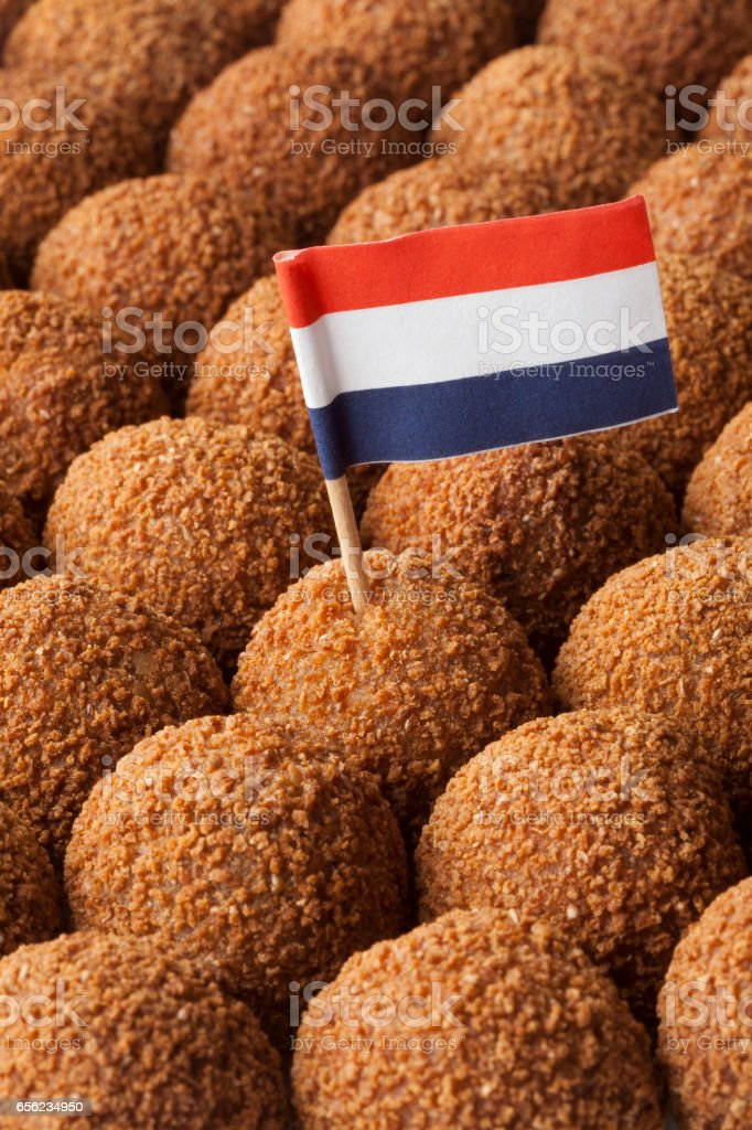 Dutch traditional snack bitterballen full frame with a dutch flag stock photo