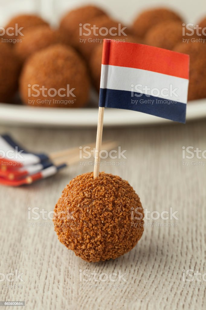 Dutch traditional snack bitterballen with a dutch flag stock photo