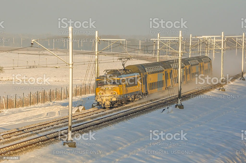 Dutch train on a winterday with snow stock photo