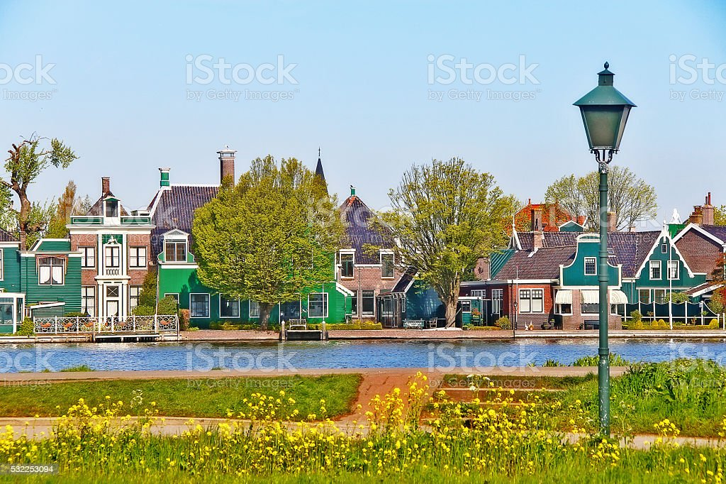 Dutch village on riverbank in Zaanse Schans, Netherlands stock photo