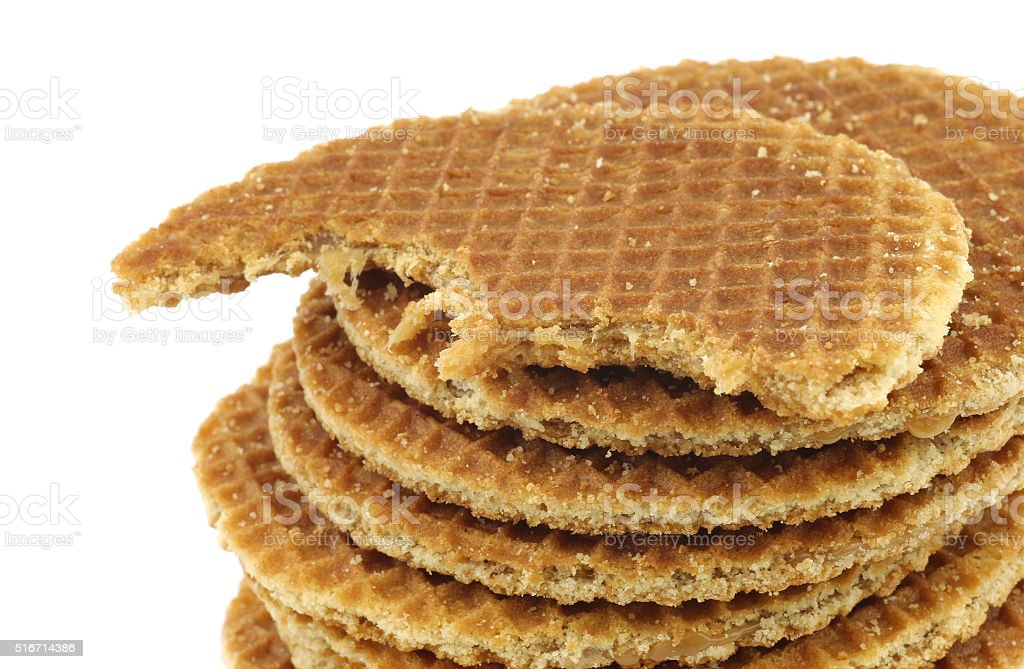 Dutch waffle called a stroopwafel with a bite missing stock photo