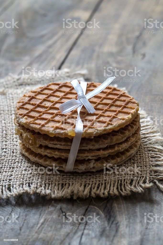 dutch waffles with caramel on wooden background stock photo