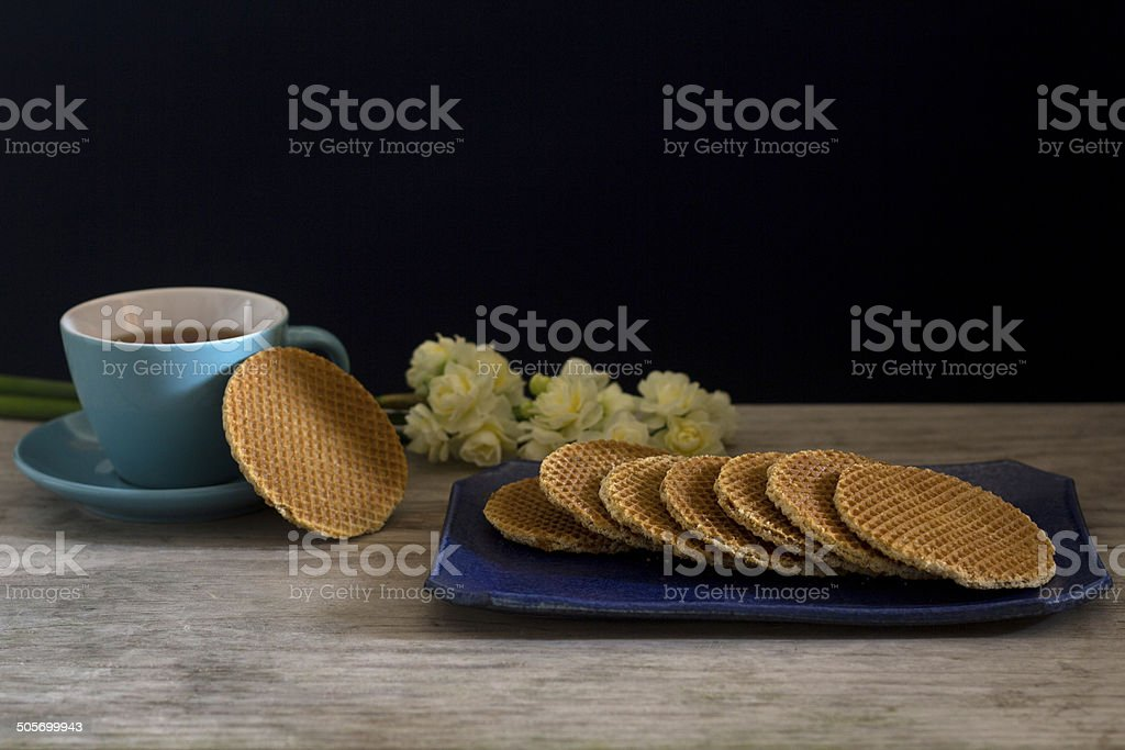 Dutch Waffles with Tea and Flowers - Selective Focus stock photo