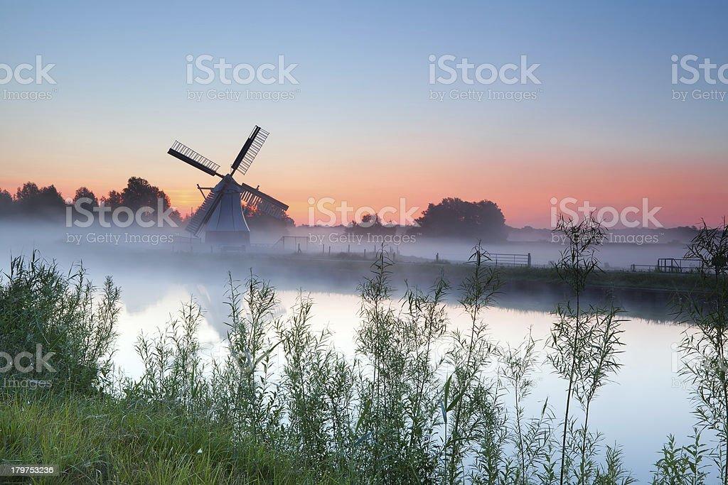 Dutch white windmill at sunrise royalty-free stock photo