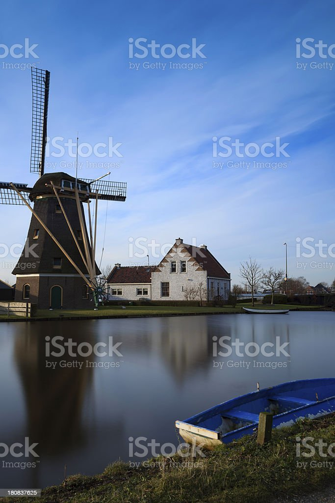 Dutch windmill against a clear blue sky royalty-free stock photo