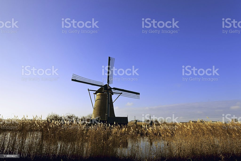 Dutch windmill against blue winter sky stock photo