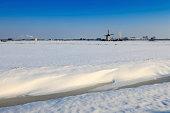 Dutch windmill in a winter landscape