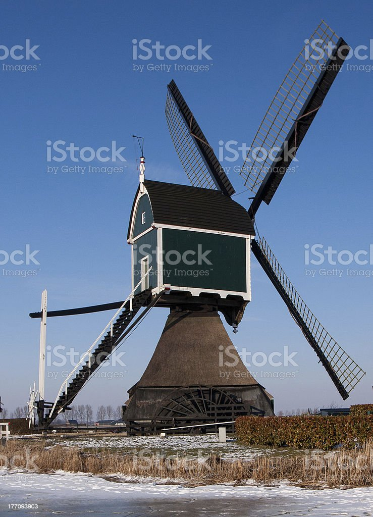 Dutch windmill in wintertime royalty-free stock photo