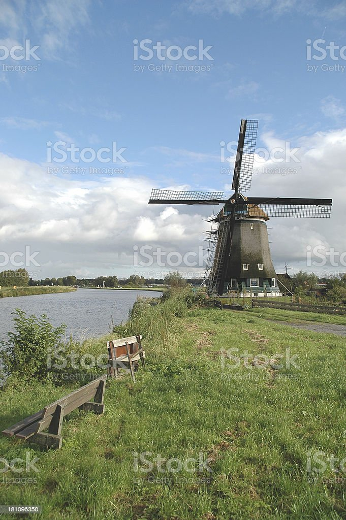 Dutch windmill next to a canal royalty-free stock photo
