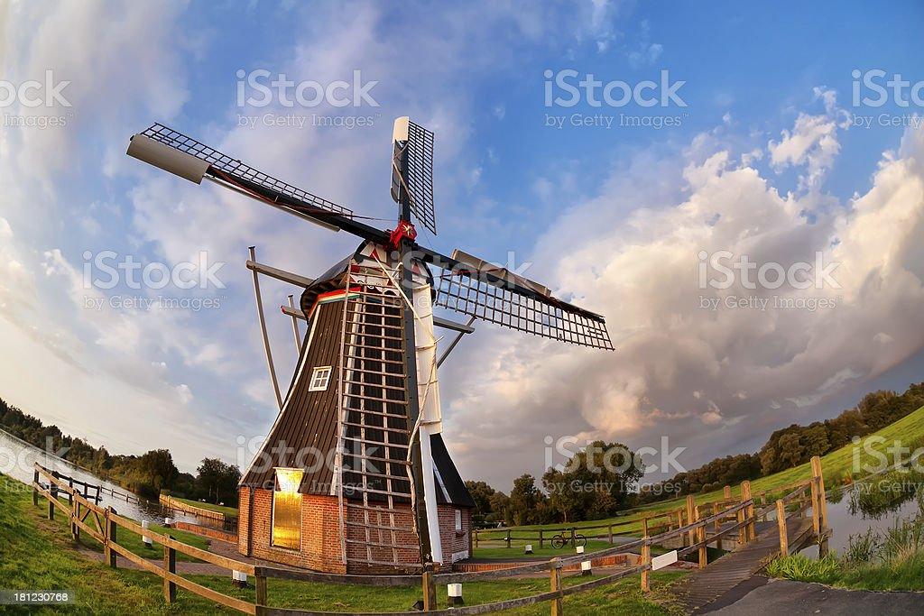 Dutch windmill over blue sky royalty-free stock photo