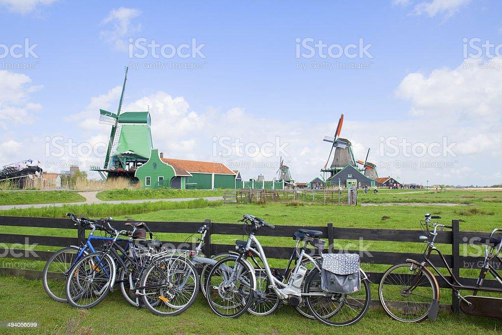 dutch windmills with bikes in Zaanse Schans stock photo