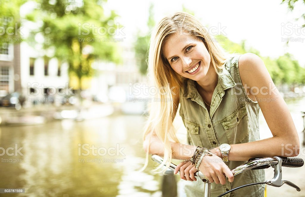 Dutch woman with bicycle in amsterdam stock photo