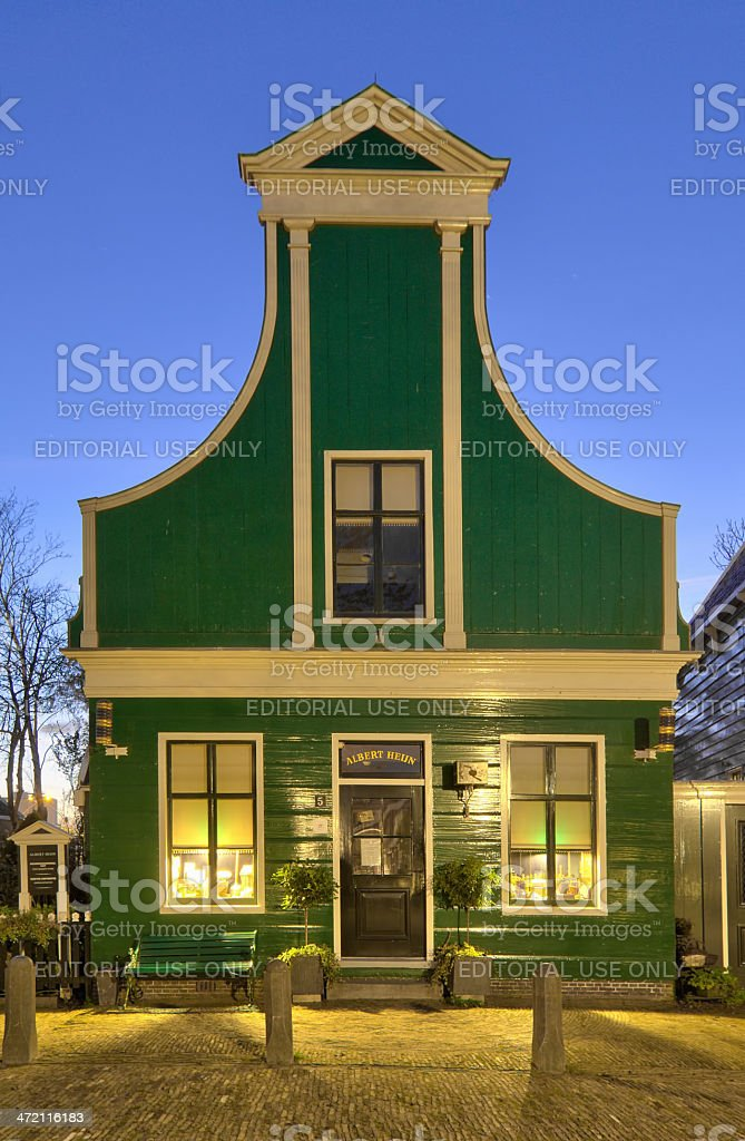 Dutch wooden house at dusk in heritage park stock photo