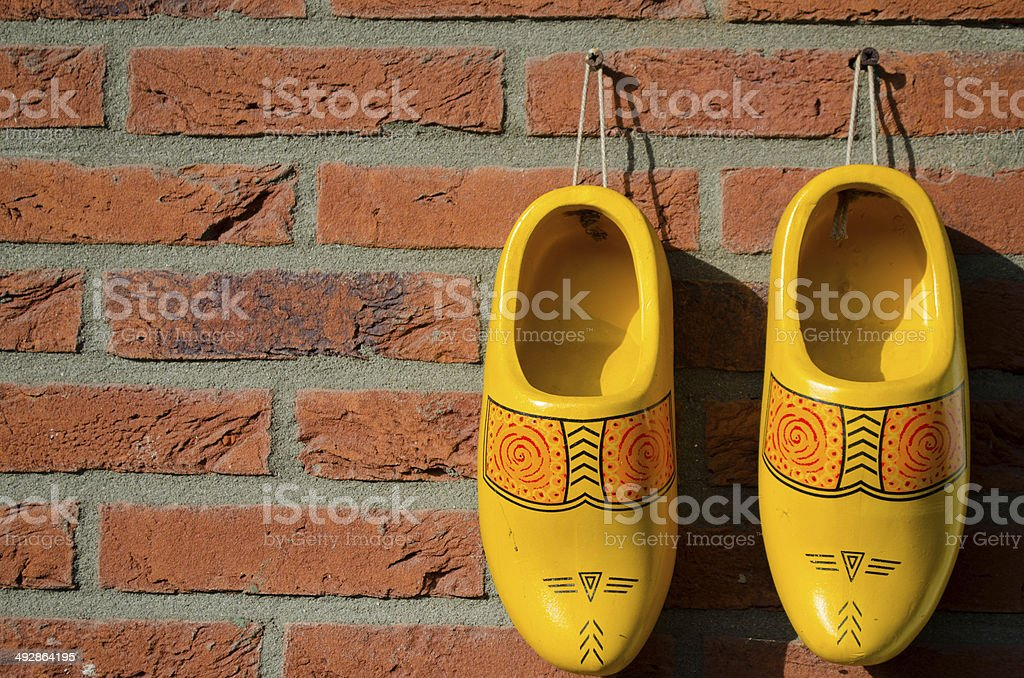 Dutch wooden shoes hanging on a wall stock photo