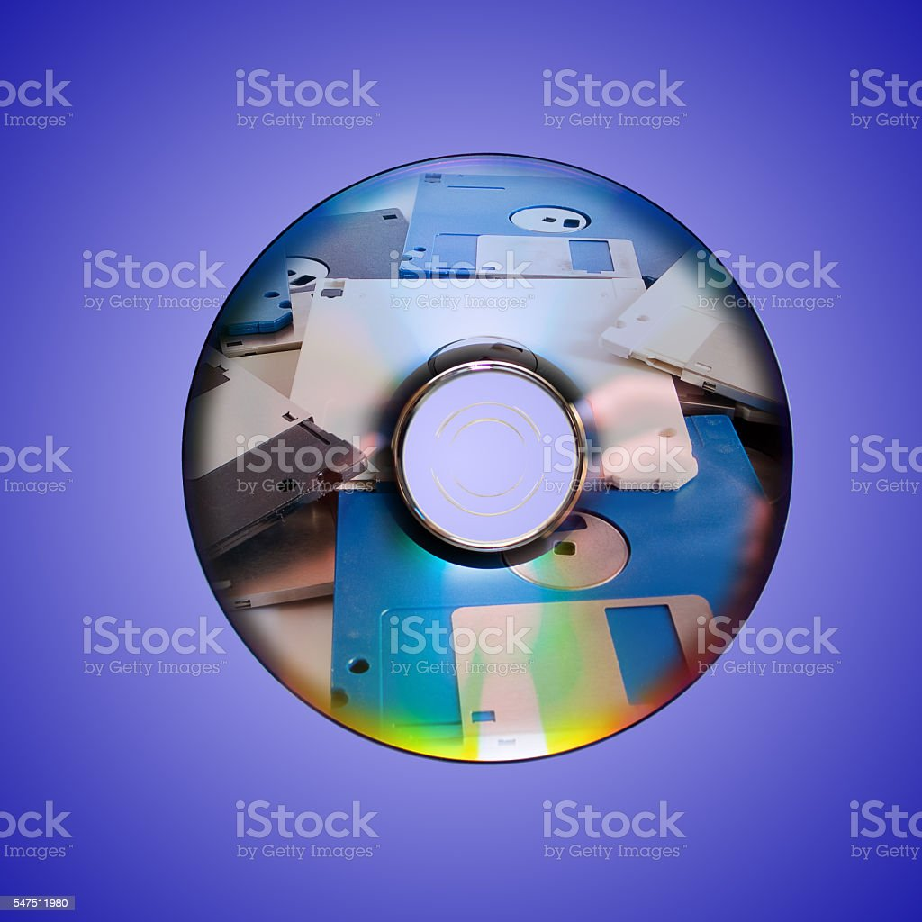Dvd or cd and old floppy disk inside stock photo